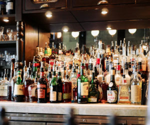 bar with liquor bottles and drinks